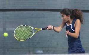 Senior Janeta Yancheva returns a serve. (Photo by Michael Dziadus)