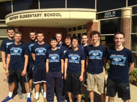 Boys' track uses day off to volunteer