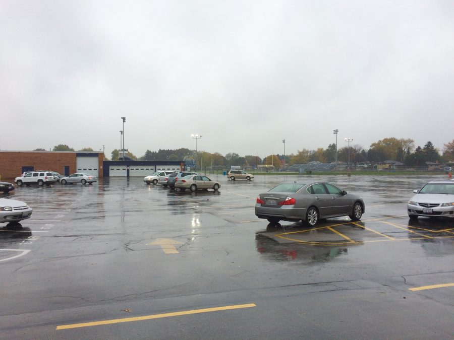 The+parking+lot+sits+partially+occupied+on+a+Saturday+morning.+Parking+permit+sales+have+abruptly+stopped+after+the+school+has+run+out+of+remaining+spaces.+%28photo+by+Riley+Langefeld%29