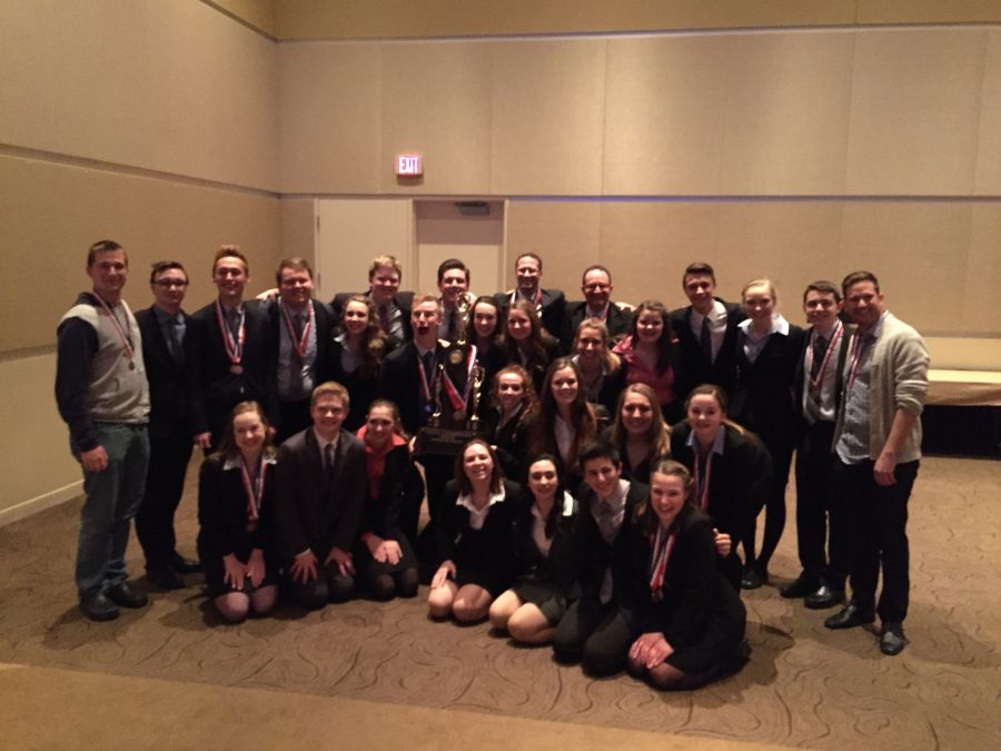 Speech+team+poses+after+receiving+state+title.