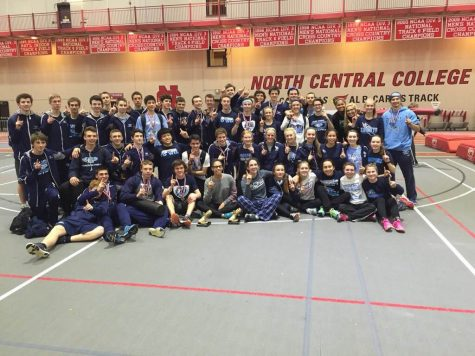 Champs: Boys' and girls' track teams gather together for a picture after they both won the indoor MSL conference title at North Central College. According to girls' coach Lance Burmeister, this was the first time ever that any team won the girls and boys title.