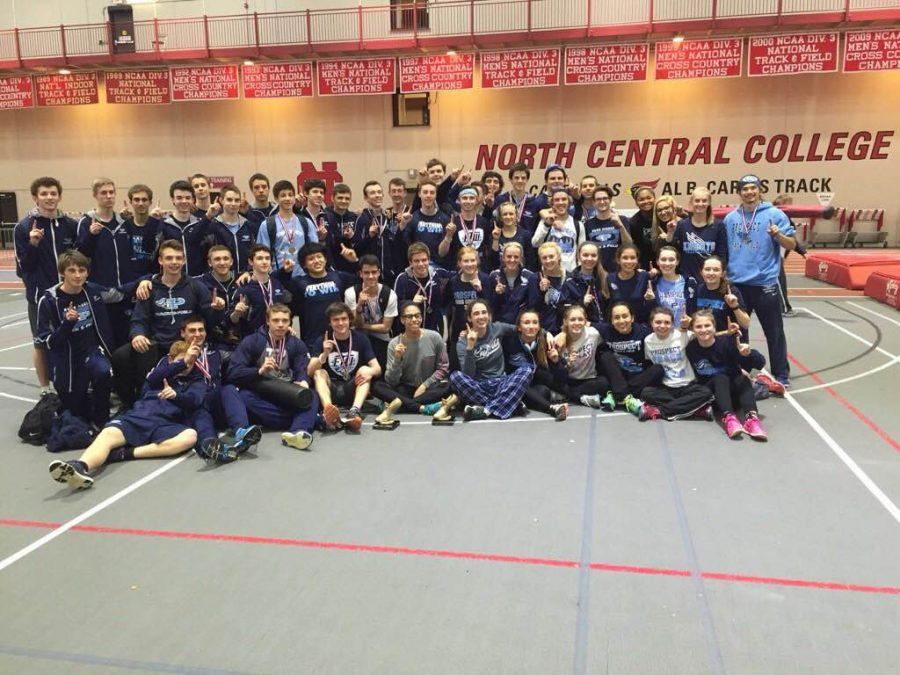 Champs%3A+Boys%E2%80%99+and+girls%E2%80%99+track+teams+gather+together+for+a+picture+after+they+both+won+the+indoor+MSL+conference+title+at+North+Central+College.+According+to+girls%E2%80%99+coach+Lance+Burmeister%2C+this+was+the+first+time+ever+that+any+team+won+the+girls+and+boys+title.%0A