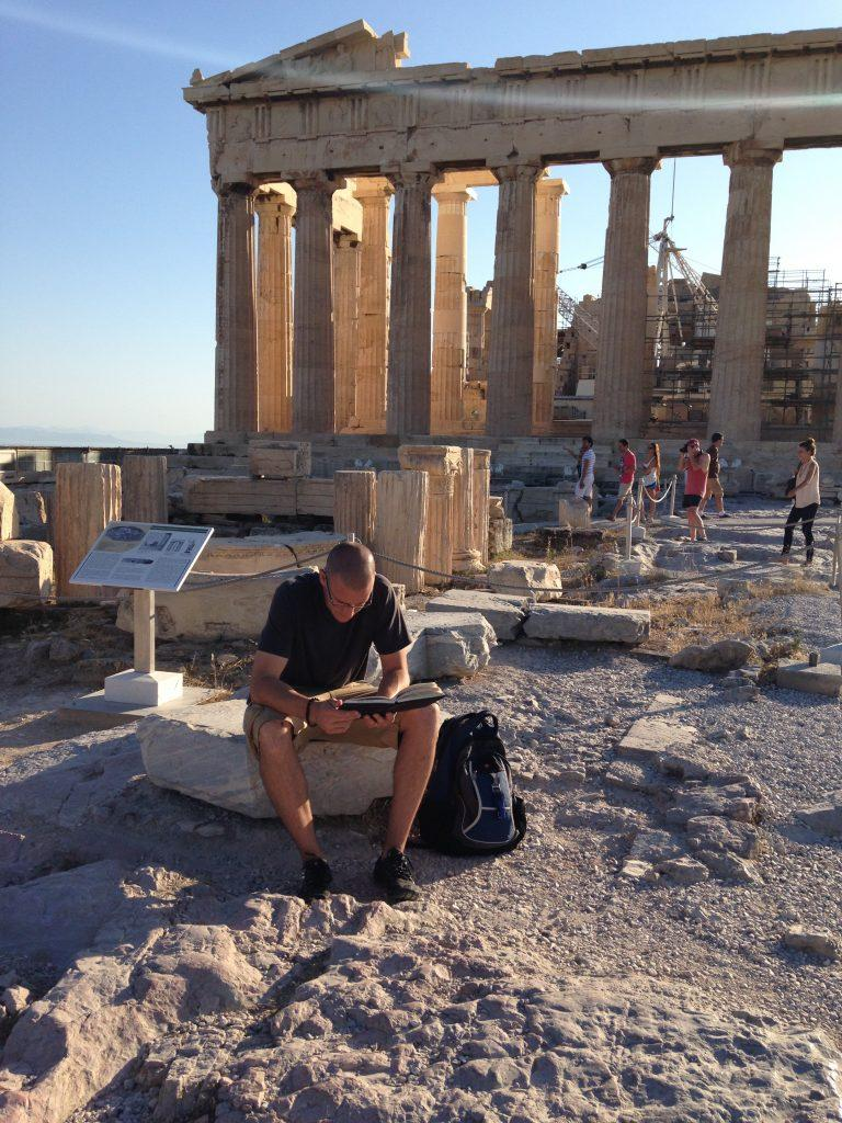 World Religions teacher John Camardella poses in front of the Acropolis in Greece. He frequently travels to other countries to gain perspective for how to better teach his classes. (photo courtesy of John Camardella)