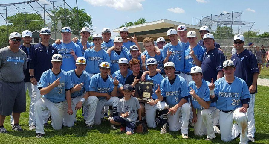 Boys baseball poses with the regional championship trophy. Winning the regional was the teams goal, and they accomplished this on May 30 by beating Glenbrook North 3-0.