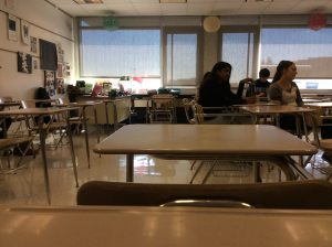 """Sophomore Kathleen Gault takes this picture of the empty desks during seventh period. Gault was one of the five people in her Honors World Literature Composition class. """"I like how teachers get really personal with you when you're like the one person in your class,"""" Gault said."""
