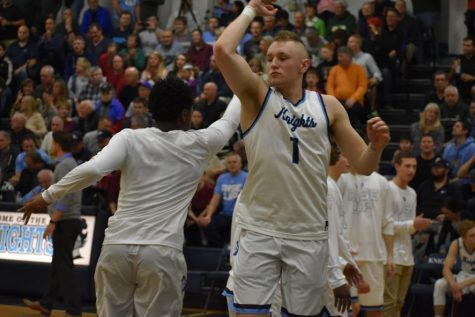 Four players receive All-Conference honors for boys' basketball