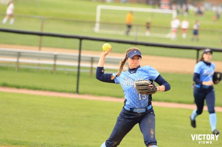 Junior+Lauren+Caldrone+throws+the+ball+to+first+in+the+Knights+game+versus+Palatine+on+May+3.+Caldrone+moved+from+third+base+to+shortstop+for+a+portion+of+the+season+when+Junior+Alyssa+Cacini+was+sidelined+with+an+ankle+injury.%0A