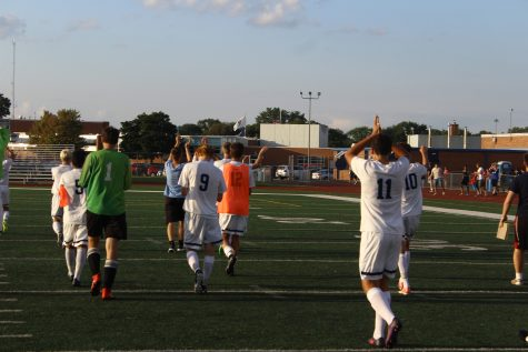 Boys' soccer takes down Glenbrook South in home opener
