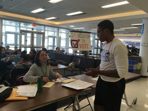A Prospect student registers to vote with a Cook County registrar for the March 20 referendum of District 57. The outcome of the referendum will determine if Lincoln Middle School, one of Prospect's main feeder schools, will keep its art and music programs.