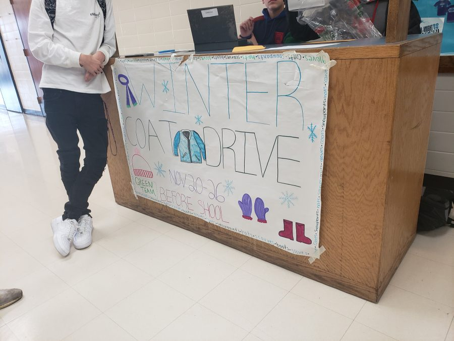 Green+team+coat+drive+collecting+donations