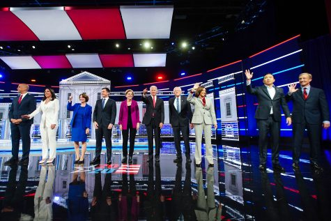2020 presidential candidates Senator Cory Booker, a Democrat from New Jersey, from left, Representative Tulsi Gabbard, a Democrat from Hawaii, Senator Amy Klobuchar, a Democrat from Minnesota, Pete Buttigieg, mayor of South Bend, Senator Elizabeth Warren, a Democrat from Massachusetts, Former U.S. Vice President Joe Biden, Senator Bernie Sanders, an independent from Vermont, Senator Kamala Harris, a Democrat from California, Andrew Yang, founder of Venture for America and Tom Steyer, co-founder of NextGen Climate Action Committee, stand on stage for the Democratic presidential debate in Atlanta, Georgia, U.S., on Wednesday, Nov. 20, 2019. The Democratic presidential races new pecking order will be on full display Wednesday night, with Pete Buttigieg taking the debate stage as the emerging front-runner in Iowa and top 2020 rivals Joe Biden and Senator Elizabeth Warren trying to knock him off that perch. Photographer: Elijah Nouvelage/Bloomberg via Getty Images