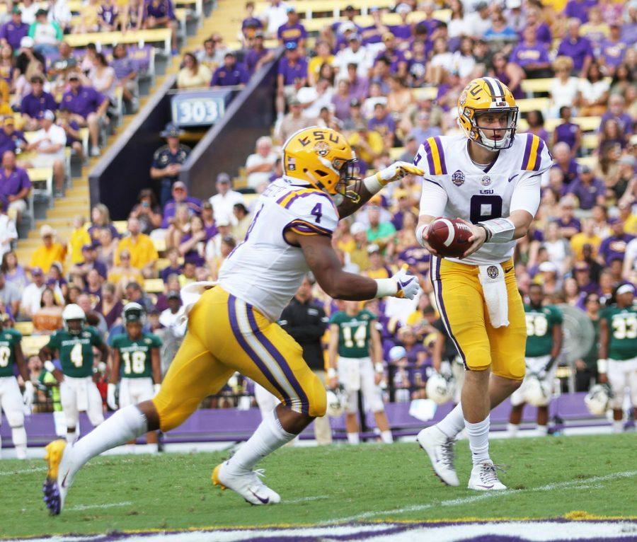 LSU+quarterback+%239%2C+Joe+Burrow%2C+hands+off+to+running+back+Nick+Brossette+%234%2C+SELU+vs+LSU+at+Tiger+Stadium%2C+September+8th+2018%2C+Tammy+Anthony+Baker%2C+Photographer