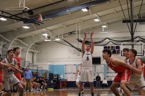 Boys basketball keeps their momentum going with definitive win at home