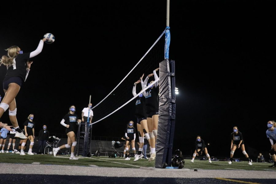 Girls' Volleyball scrimmages under the lights at George Gattas Memorial Stadium on Oct. 7. (photo by Mara Nicolaie)