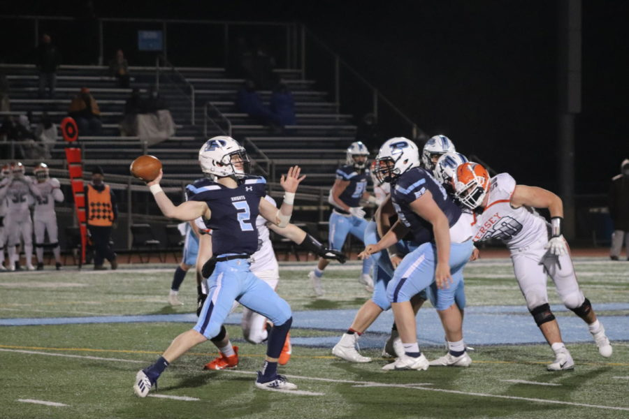 Quarterback+Gary+Moeller+passed+for+333+yards+and+four+touchdowns.+He+also+added+a+rushing+touchdown+and+an+interception+returned+for+a+touchdown.+%28photo+by+Alexis+Esparza%29