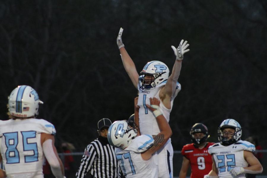 Junior Owen Walter (#1) celebrates a 19 yard touchdown with senior Matt Pankauskas (#77) in the MSL championship game against Barrington. (photo by Abby McKenna)