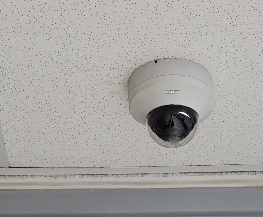 A Prospect security camera keeps a watchful eye over the Band-Arts hallway